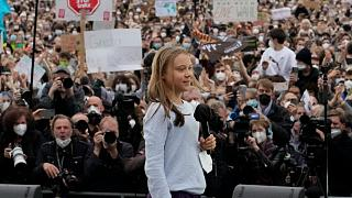 wedish climate activist Greta Thunberg at a stage during a Fridays for Future global climate strike in Berlin, Germany, Friday, Sept. 24, 2021.