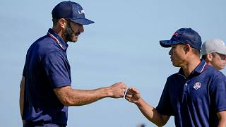 Team USA's Dustin Johnson and Collin Morikawa celebrate during their foursomes match on Saturday.
