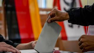 A man casts his ballot for the German elections in a polling station in Berlin, Germany, Sept. 26, 2021.