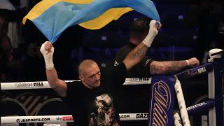 Oleksandr Usyk of Ukraine holds up the Ukrainian flag after his unanimous decision victory over Anthony Joshua of Britain, in London, Sept. 25, 2021.