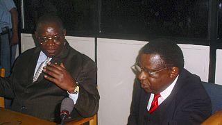 Anatole Nsengiyumva (à gauche) et Theoneste Bagosora (à droite) lors de leur comparution devant le Tribunal pénal international pour le Rwanda à Arusha (Tanzanie) en 2008.