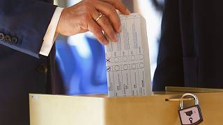 Armin Laschet, Christian Union parties candidate for Chancellery, casts his ballot for the German parliament election in Aachen, Germany, Sept. 26, 2021.