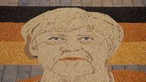 Kosovar artist makes Merkel mosaic from seeds