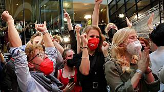 Supporters react after German parliament election at the Social Democratic Party, SPD, headquarters in Berlin, Sunday, Sept. 26, 202