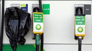 """A """"sorry out of use', sign's are seen on fuel pump's at a gas station in Washington, England, March. 29, 2012."""