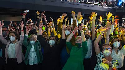 Members and supporters of the Green Party (Die Gruenen) gesture at the Green Party event after the close of polling stations.