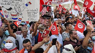 Demonstrators chant slogans during a protest in Tunisia's capital Tunis on September 26, 2021, against President Kais Saied's recent steps to tighten his grip on power.