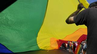 A rainbow flag is waved at a Pride march in the Polish city of Czestochowa.