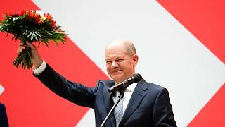 Olaf Scholz, top candidate for chancellor of the Social Democratic Party (SPD), holds a bunch of flowers after a press statement at the party's headquarter in Berlin, Germany