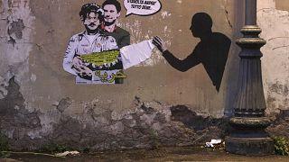 Un murale con Patrick Zaki e Giulio Regeni