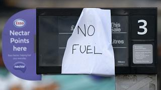 A sign indicating that fuel has run out is seen at a petrol station in Manchester, Sept. 27, 2021.