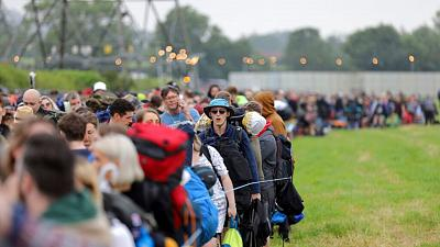 Festival goers arrive for the Glastonbury Festival at Worthy Farm, Somerset, England.