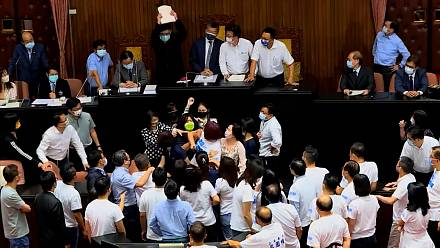 Taiwanese lawmakers brawl during a political speech