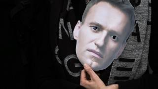 A mask of Russian opposition leader Alexei Navalny is held at a rally in Berlin.