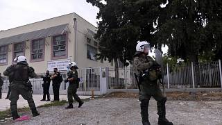 Riot police guard outside a vocational high school after clashes in the northern city of Thessaloniki.
