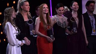 U.S. actress Jessica Chastain, center dressing red, poses with other winners after receiving an ex-aequo Donostia Shell award at the San Sebastian Film Festival.
