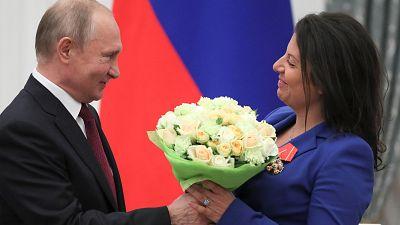 Russian President Vladimir Putin presented RT editor Margarita Simonyan with an award in 2019