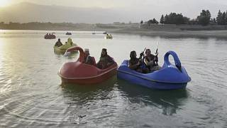 Taliban fighters hit a Kabul fairground as Afghans fear for freedoms