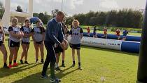 Duke and Duchess of Cambridge kick rugby balls while visiting Northern Ireland