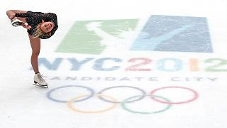 Ukraine's Olympic gold medal figure skater Oksana Baiul performs during a rally at Rockefeller Center Skating Rink in New York City