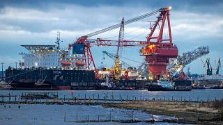 """Tugboats get into position on the Russian pipe-laying vessel """"Fortuna"""" in the port of Wismar, Germany, January 2021."""