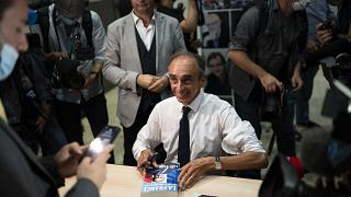 Eric Zemmour signs his latest book Friday, Sept. 17, 2021 in Toulon, southern France.