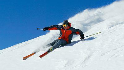 Man skis down a mountain