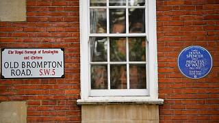 The English heritage plaque marks her place of residence before marrying Prince Charles