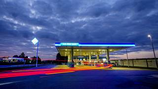 In this Sunday, Sept. 12, 2021 file photo, a long exposure photo shows a car approaching a gas station at a highway in Frankfurt, Germany.