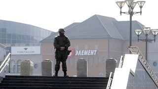A Belarusian interior ministry soldier guards an empty street in Minsk.