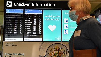 A woman proceeds to the check-in counter for New Zealand flights at Sydney International Airport on April 19, 2021.