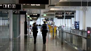 Police officers guard through the deserted airport in Munich.