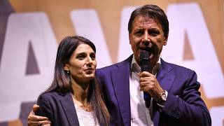 Incumbent Rome mayor and fellow Five Star movement member, Virginia Raggi (L) with ex-Italian prime minister Giuseppe Conte, during a campaign rally in Rome, October 1, 2021.