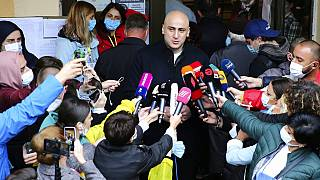 Nika Melia, head of the United National Movement, speaks to the media after voting at a polling station during national municipal elections in Tbilisi, October 2, 2021.