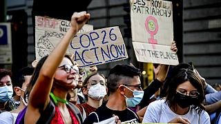 People take down to the streets in the wake of the three-day Youth for Climate summit, in Milan, Italy, Saturday, Oct. 2, 2021.