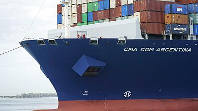 In this April 6, 2021 photo, crew members stand on the bow as the CMA CGM Argentina arrives at PortMiami, the largest container ship to call at a Florida port in Miami