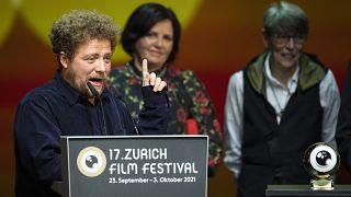 Renato Borrayo Serrano receives the Golden Eye Award for 'Life of Ivanna' during award night at the 17th Zurich Film Festival in Switzerland, October 2, 2021.