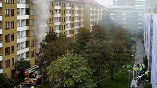 The explosion and fire at a large apartment building last week that injured 16 people, four of them seriously.