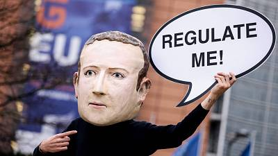 Activists called for the EU to regulate Facebook during a demonstration in December last year