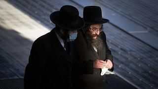 Two ultra-Orthodox Jewish men are pictured in Antwerp, Belgium.