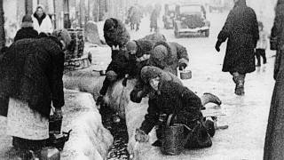 This file photo, taken in 1942, shows citizens of Leningrad as they dig up water from a broken main, during the 900-day siege of the Russian city by German invaders