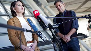 Annalena Baerbock, left, co-chairwoman of the German Green party (Die Gruenen), and Robert Habeck, the party's co-chairman, give a press conference on coalition talks