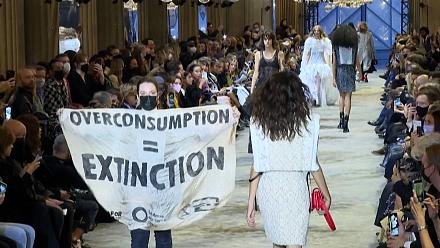Climate protesters invade the Louis Vuitton fashion show in Paris