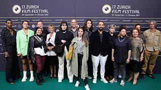 The cast of La Mif join director Fred Baillif on Zurich Film Festival's green carpet