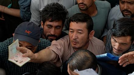 Afghans flock to passport office reopened by Taliban