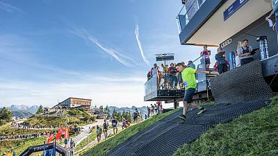 Runners start the race from the Starthaus at the top of the Hahnenkamm ski slope