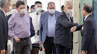 Taiwan's deputy foreign minister Harry Tseng (R) greets French Senator Alain Richard (2nd R) leading a delegation arriving at the Taoyuan international airport on October 6.