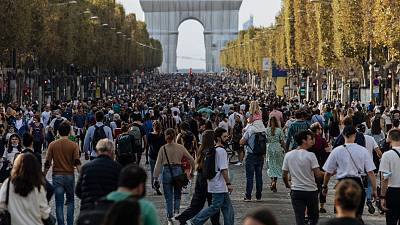 Pedestrians walking along the Champs-Elysees on Paris's car-free day 2021.