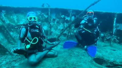 Divers practise yoga under the Caribbean sea