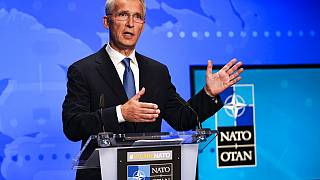 In this Friday, Aug. 20, 2021 file photo, NATO Secretary General Jens Stoltenberg gestures during an online news conference at NATO headquarters in Brussels.